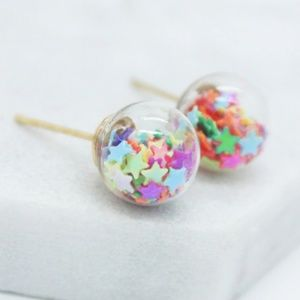 New, glass ball earrings with colorful stars